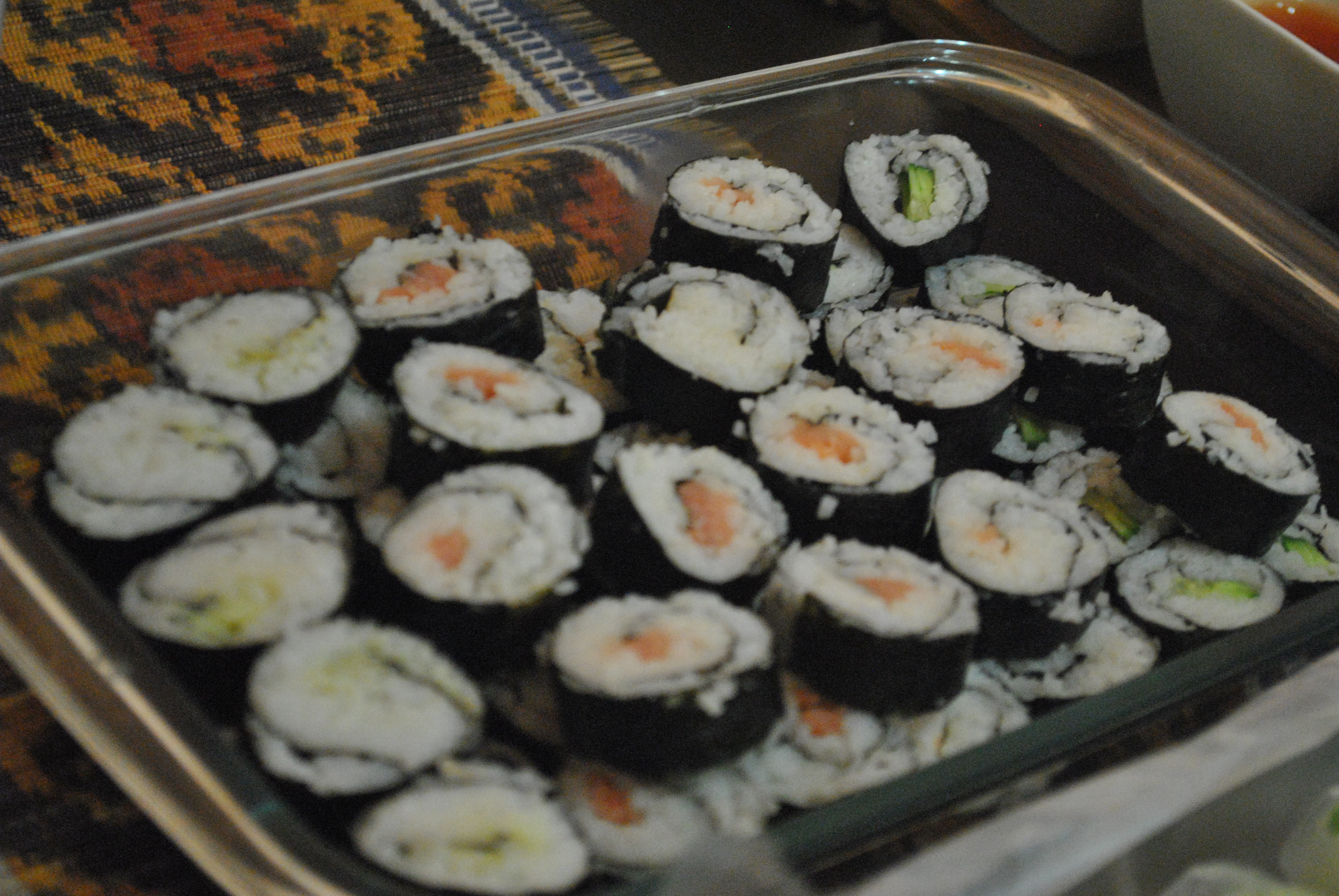 Sushi with salmon, avocado, and cucumber